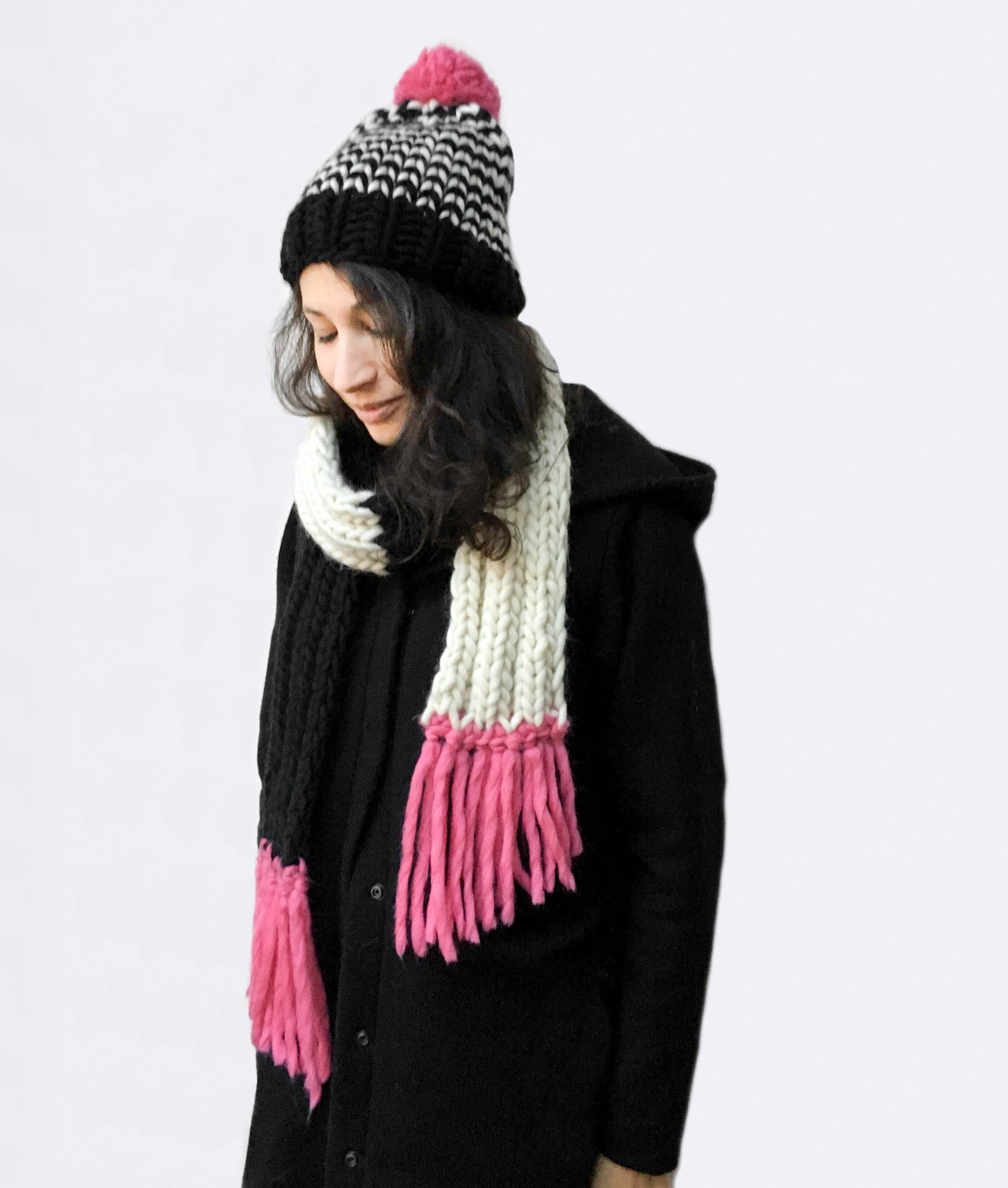 Handmade woolly scarves - Black and Ivory scarf with Bubblegum tassels. Click to customise.
